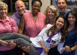 Fun photo of dentist Dr. Tram Vu and her team