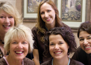 Fun photo of Periodontist Dr. Vanessa Marinho and her dental team