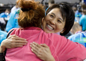 Dentist Dr. Thuy Ngo hugs patient at AzMOM