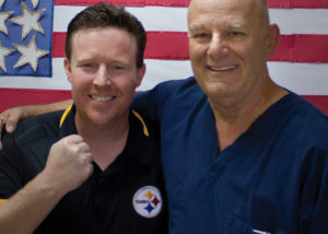 SVdP Dental Director Dr. Ken Snyder poses with Jeremy Tuber