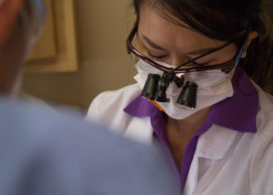 Close up of Phoenix dentist Dr. Tram Vu wearing loupes