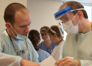 Dentists reviewing patient chart