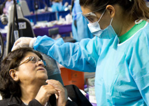 Hygienist consoles dental patient at charity event in Phoenix, Arizona