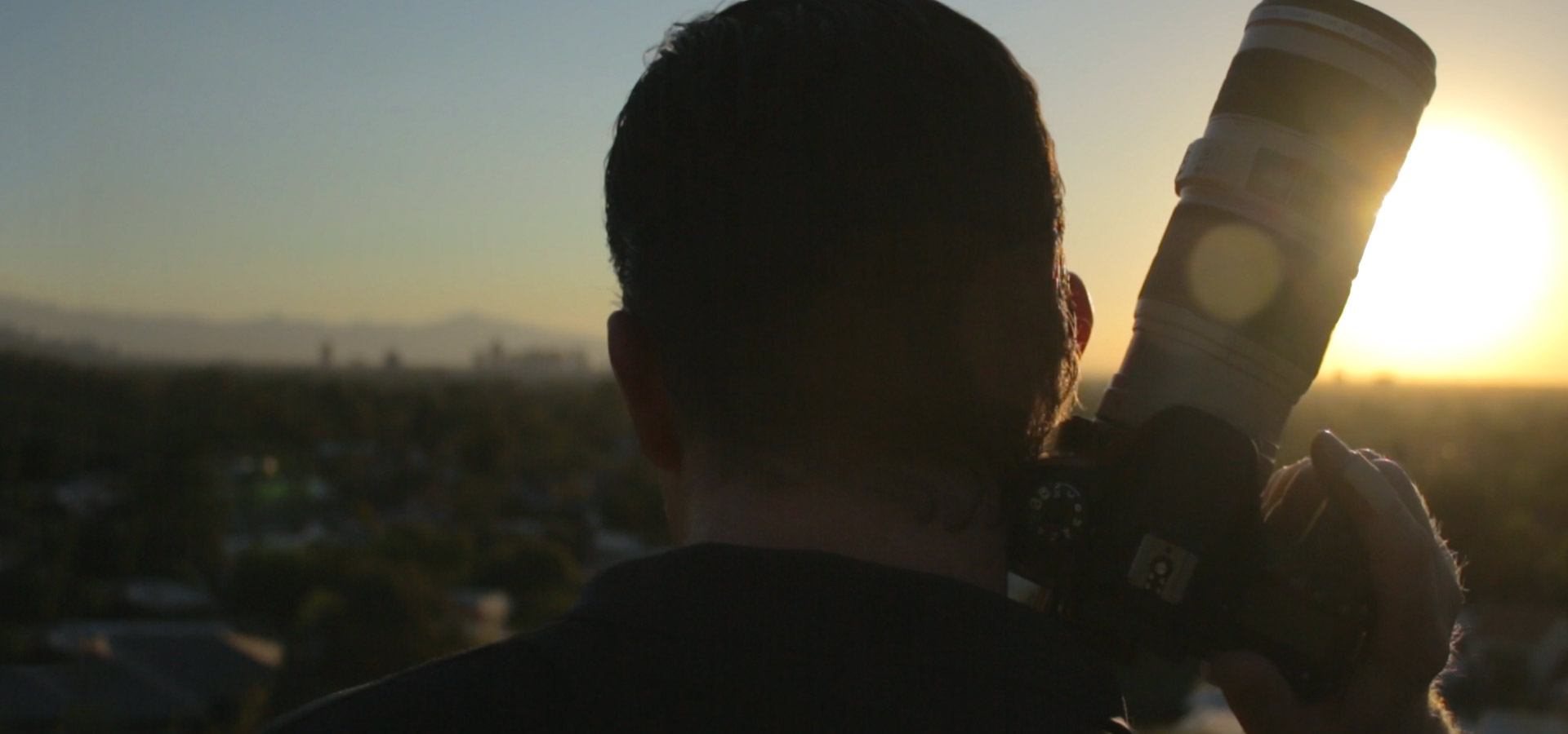 Film marketer Jeremy Tuber with camera looking at Phoenix, Arizona.